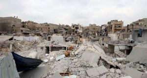 A general view shows damaged buildings in al-Kalaseh neighborhood of Aleppo