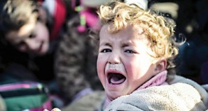 A Syrian child cries as Syrians fleeing the northern embattled city of Aleppo wait on February 5, 2016 in Bab-Al Salam, next to the city of Azaz near Turkish crossing gate in northern Syria.  Nearly 40,000 Syrian civilians have fled a regime offensive near Aleppo, a monitor said, as Turkey warned it was bracing for a wave of tens of thousands of refugees. / AFP / BULENT KILIC