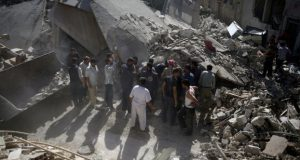 Civil defence members and civilians search for survivors after an airstrike in the rebel held Douma neighborhood of Damascus, Syria July 22, 2016. REUTERS/Bassam Khabieh