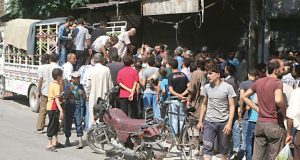 People gather to buy fresh produce that was brought into rebel held areas of Aleppo by private traders from a newly opened corridor that linked besieged opposition held eastern Aleppo with western Syria that was captured recently by rebels, in Aleppo, August 11, 2016. REUTERS/Abdalrhman Ismail